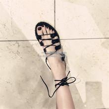 高制17夏新款 欧美黑色铆钉绑带平底凉鞋 厚底露趾罗马沙滩女鞋潮