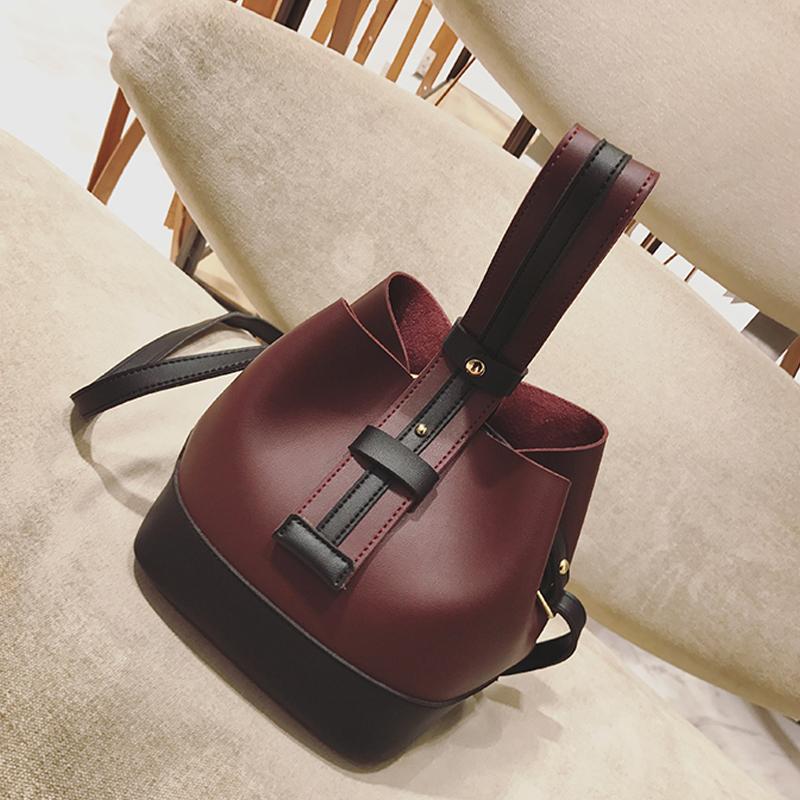 手提包包女2017新款时尚韩版撞色水桶包个性复古单肩包简约斜挎包