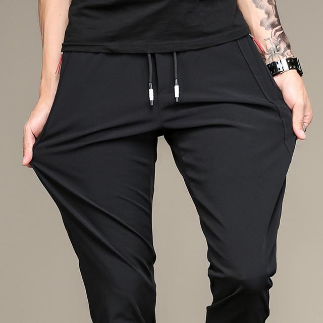青年休闲长裤 黑色修身 子男生弹力宽松运动裤 小脚松紧卫裤 夏季薄款
