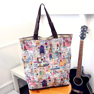 [限时促销] 2015英国复古碎花女包包帆布防水拉链购物袋折叠环保袋便当包包邮