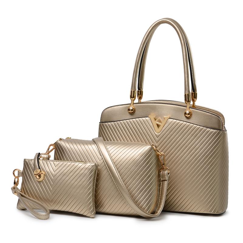 2015春夏新款大容量通勤手提女包 时尚复古潮流压纹子母包