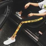 2017夏新款韩版女装裤装字母金色潮流运动裤休闲女裤黄边飘带黑裤