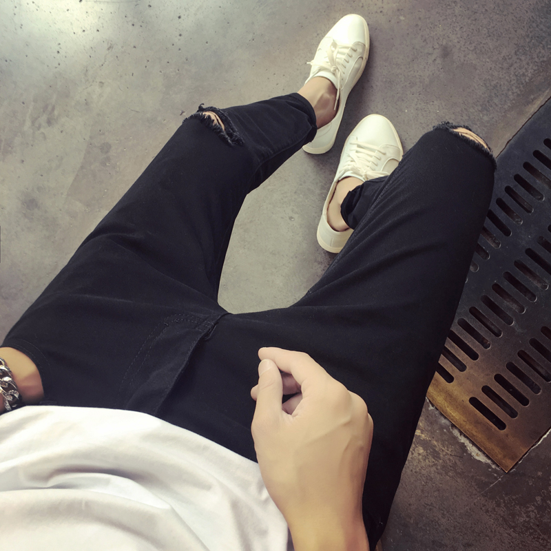 男韩版小脚乞丐夏季牛仔裤裤子修身膝盖黑色学生破洞